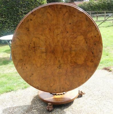 A Large Victorian Walnut Pedestal Tilt Top Table Sitting On Chunky Claw Feet