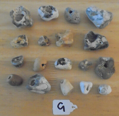 parcel of 18 medium sea beach pebbles stones with holes lucky craft G FAST POST