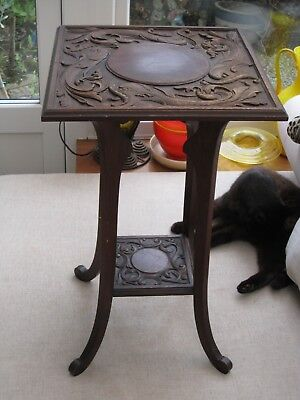 Art Nouveau carved wooden side table with mythical dolphins