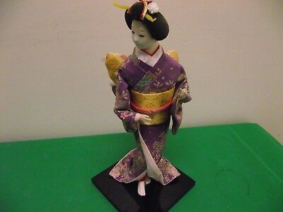 Japanese Geisha Girl Doll on stand.12 inches high