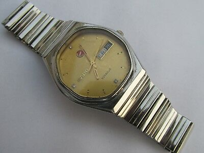 Men's Rado Voyager Automatic 2836-1 Day-Date Golden Dial Watch Swiss Made