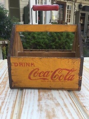 An original and scarce wooden Coca Cola 6 bottle carrier. 1940s. Very nice!!