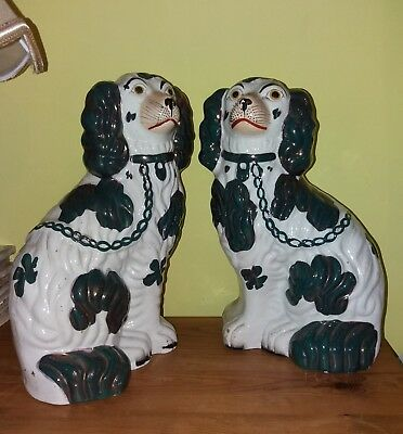19thc Staffordshire Copper Lustre Pottery Hearth dogs, moulded 2 marks to base.