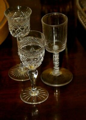 Three small cut glass liquer glasses. One opaque twisted stem.