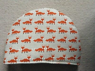 Foxes in Lines Tea Cosy