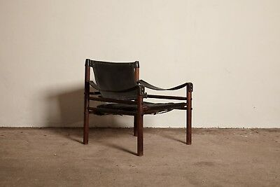 An Arne Norell safari sirocco chair in black leather, Sweden, 1960s.