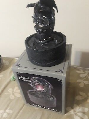 mystical creations dragon led water fountain.used few times with box