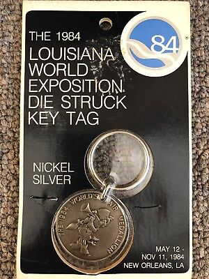 Lot of 7 Louisiana World Exposition 1984 Die Struck Key Tags MIP Sealed
