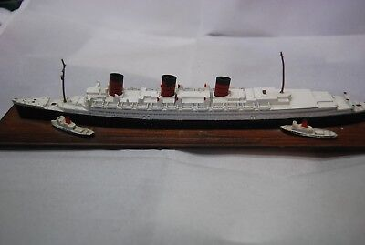 RMS Queen Mary Die Cast Model mounted on wood base, Good Condition