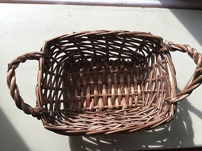 Natural unpeeled reed basket with handles. Good for bread or other food.