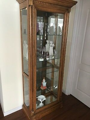 Curio Cabinet Used. Oak And Lighted With Glass Selves