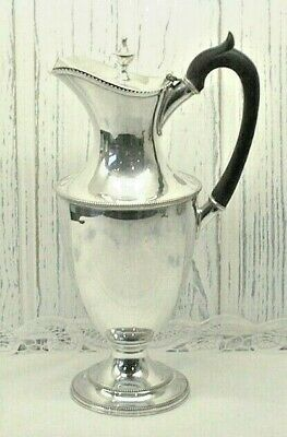 Victorian silver plated claret jug by Walker & Hall. Urn shaped pitcher with lid