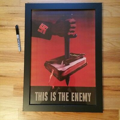 "Reproduction Wwii ""this Is The Enemy"" Nazi Knife In Bible Poster-Framed"