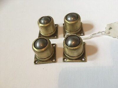Four Acme brass antique furniture ball castors. 2.5cm H