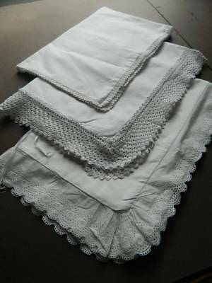 Three (3) vintage white Oxford pillowcases with hand worked lace borders.