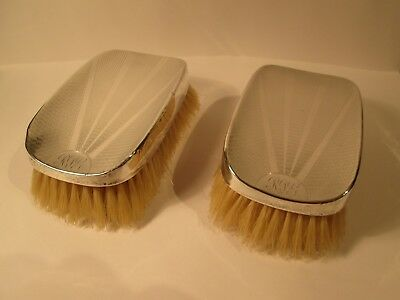 Pair of antique sterling silver backed Brushes