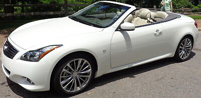 2015 Infiniti Q60 Hardtop Convertible 9500 miles. Never in rain. Heated storage. Factory Warranty. Best in the country