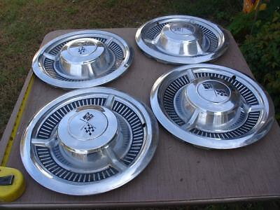Four Used 58 chevy Impala  Hubcaps