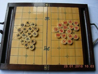 Vintage or antique wooden Chinese chess set in folding box board