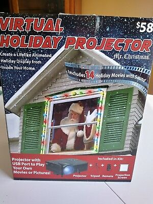 Mr. Christmas Virtual Holiday Projector -14 Holiday Movies w/Sound NEW in Box