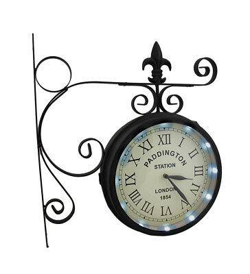 Zeckos Double Sided Paddington Station Solar Powered LED Lighted Wall Clock