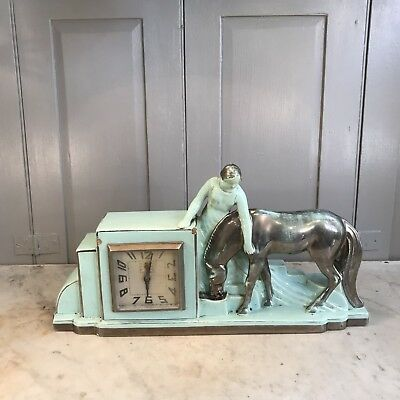 Antique French Art Deco blue ceramic mantel clock woman with horse