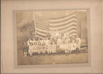 Vintage studio photograph elementary school class with 45 star US flag