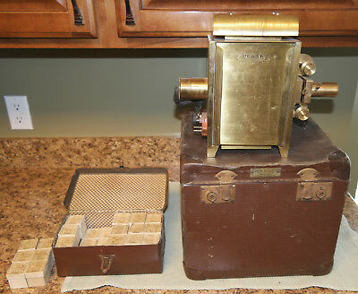 """ORNAK of Warsaw POLAND """"scarce"""" BRASS FILM PROJECTOR w/36 boxes film & cases"""
