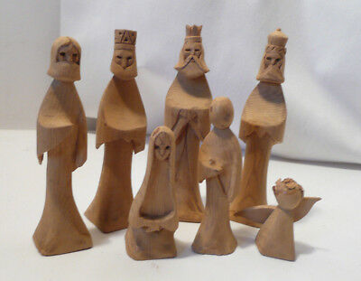 "HAND CARVED WOOD FIGURES c   Seven hand carved pieces light weight ""Waldorf"""