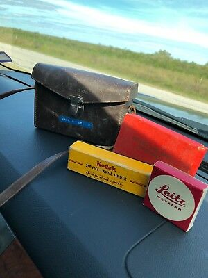 vintage tuck-tite leather camera bag and box accessories.