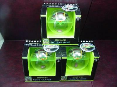 3 NEW Sharper Image Hand Held Electronic Football Game Flashing LED Lights Sound