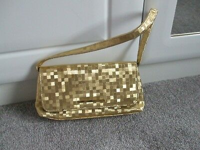 NEW UNUSED.  EVENING BAG by UNICCO. GOLD