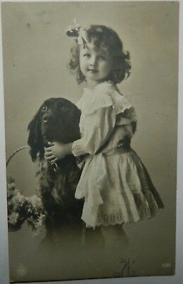 Vintage photo postcard: Cute young girl wither her black cocker spaniel dog 1911