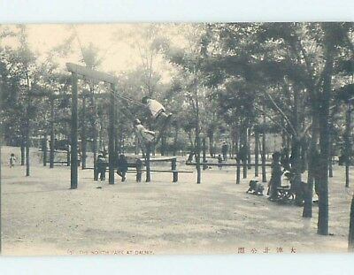 old card CHILDREN ON SWING SET AT NORTH PARK Dalny - Dairen - Dalian China F4754