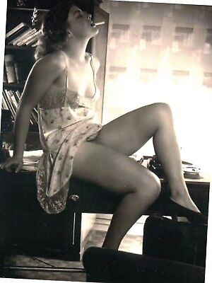 Postcard Of Vintage Photograph Sitting On Desk With Her Legs Propped Up Smoking