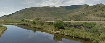 160 ACRES in Grand County Colorado on Co Road 33 with River access and electric