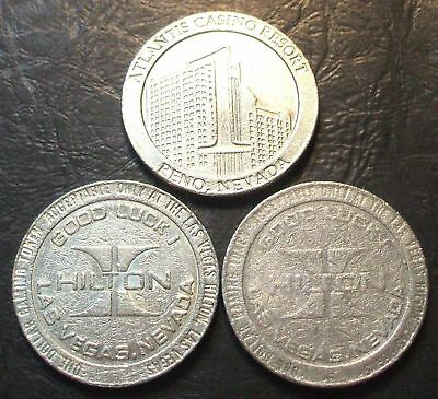 3 - $1. Casino Gaming Tokens - Nevada - Atlantis & Hilton - 1970s & 1980s