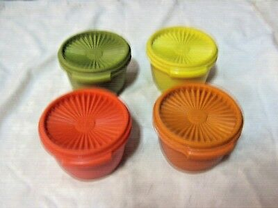 A Set of 4 Retro Vintage Tupperware Star Pattern Press Seal Container Bowls