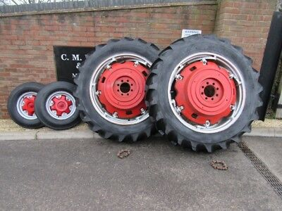 COMPLETE SET OF PAVT WHEELS AND TYRES FROM A MF 178 MASSEY FERGUSON 13.6x36