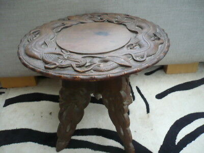 Antique quality wooden Chinese style table signed depicting carved dragons