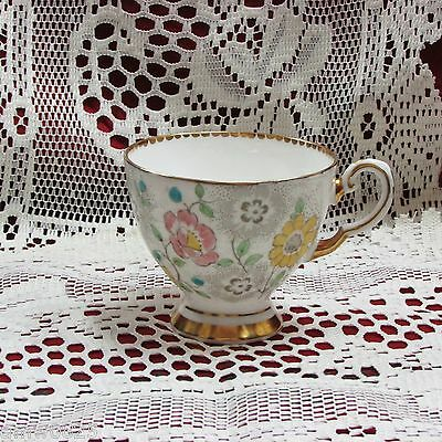 VINTAGE COALPORT BONE CHINA FOOTED TEACUP only PINK YELLOW HAND PAINTED FLOWERS