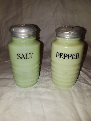jadeite salt and pepper shakers. Lids have dents as shown in pictures