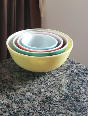vintage pyrex nesting mixing bowls 4 piece. yellow,green,red,blue