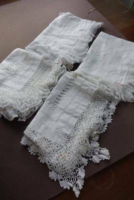 Four (4) antique white Irish linen table toppers with lace edges.