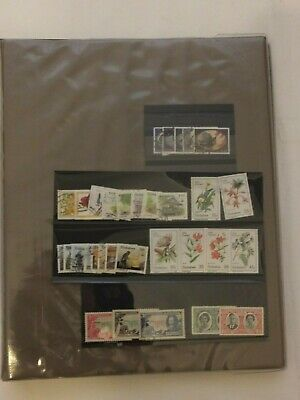 RHODESIA (N&S) ZAMBIA ZIMBABWE collection in ALBUM early to 80s - 600+ stamps