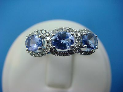 1.0Ct Tw Genuine Tanzanite Accented By 0.25Ct Tw Diamonds Ladies White Gold Ring