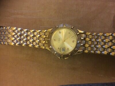 OLD yellow metal quartz jcayier watch made in japan with genuine diamonds chips