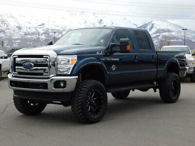 2015 Ford SUPER DUTY F-350 LARIAT LIFTED FORD CREW CAB LARIAT 4X4 POWERSTROKE DIESEL CUSTOM WHEELS TIRES LEATHER
