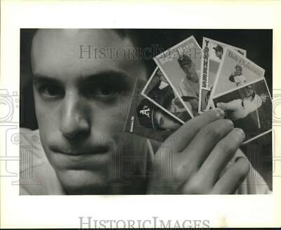 1988 Press Photo Jay Ory Jr. holds favorite collectible baseball cards