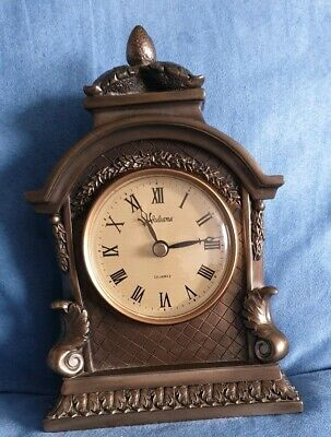 Juliana Quartz Mantel Clock With A Bronze Look and Roman numerals